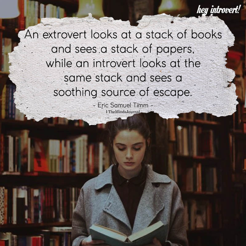 An Extrovert Looks A Stack Of Books