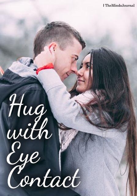 Hug while making eye contact