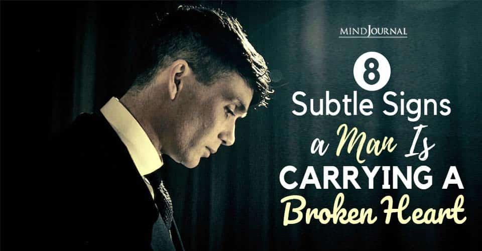 signs man carrying broken heart
