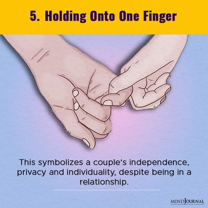 holding onto one finger